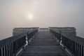 Dock in fog landscape of at sunrise whitford lake fort custer state park michigan usa Royalty Free Stock Images