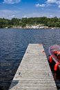 Dock in lake muskoka boating large cruise ship background Stock Image
