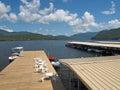 Dock on lake placid ny adirondacks outdoor tables and chairs lakeside new york Royalty Free Stock Photo