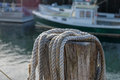 Dock side hemp hawser rope ready to be used to moor lobster boat Royalty Free Stock Photo