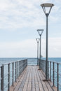 Dock with street lighting pole Stock Images