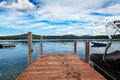 Dock on summer lake Stock Photography