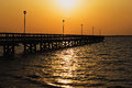 Dock at sunset in long beach island nj bay a deep golden illuminates a on the jersey shore and glistens on the water of the Royalty Free Stock Images