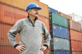 Dock warehouse worker adult terminal cargo in front of maritime shipping container Royalty Free Stock Photos