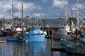 Docked fishing boats commercial and private at the historic bay front in newport oregon Royalty Free Stock Image