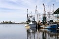 Docked shrimpers boats commercial by a pier in a small bay Stock Photography