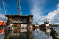 Docking oil rig at the gdansk shipyard with fisher man poland september unidentified fishing in front of a under construction Royalty Free Stock Photos
