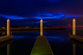 Docks and pier posts in a marina at night, in Kent Island Royalty Free Stock Photo