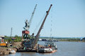 Dockside cargo crane at river port Royalty Free Stock Photo
