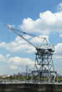 Dockside crane in red hook section of brooklyn ny august with the view freedom tower and downtown manhattan at Royalty Free Stock Photos