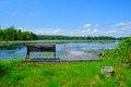 Dockside view of pecks pond scenic in the pocono mountains from dock with a park bench Stock Photos