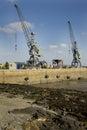 Dockyard cranes against a cloudy sky guernsey channel islands Stock Photos