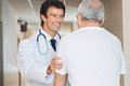 Doctor assisting senior man happy young men in the hospital Royalty Free Stock Images