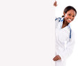 Doctor with a banner ad female isolated over white background Royalty Free Stock Photos