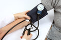 Doctor checking blood pressure with stethoscope Royalty Free Stock Photo