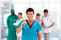 Doctor with colleagues in the background Royalty Free Stock Photography