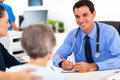 Doctor consulting senior medical patient in office Royalty Free Stock Photo