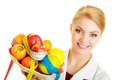 Doctor dietitian recommending healthy food diet woman in white lab coat holding fruits and colorful measure tapes isolated Royalty Free Stock Photo