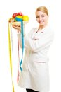 Doctor dietitian recommending healthy food diet woman in white lab coat holding fruits and colorful measure tapes isolated Royalty Free Stock Photos