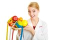 Doctor dietitian recommending healthy food diet woman in white lab coat holding fruits and colorful measure tapes isolated Stock Photos