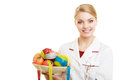 Doctor dietitian recommending healthy food diet woman in white lab coat holding fruits and colorful measure tapes isolated Royalty Free Stock Photography