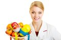 Doctor dietitian recommending healthy food diet woman in white lab coat holding fruits and colorful measure tapes isolated Stock Photography