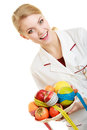 Doctor dietitian recommending healthy food diet woman in white lab coat holding fruits and colorful measure tapes isolated Royalty Free Stock Images