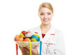 Doctor dietitian recommending healthy food diet woman in white lab coat holding fruits and colorful measure tapes isolated Stock Images