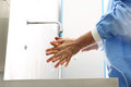 The doctor disinfects his hands washes disinfect their before surgery Royalty Free Stock Photography