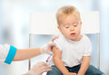 Doctor does injection child vaccination baby a Stock Photography
