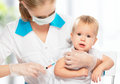 Doctor does injection child vaccination baby a Royalty Free Stock Images