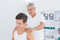 Doctor doing back adjustment in medical office Stock Photography