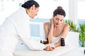 Doctor doing skin prick test at her patient in medical office Royalty Free Stock Photos