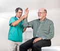 Doctor Examines Patient's Wincing with Pain in Arm Royalty Free Stock Images