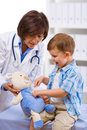 Doctor examining child Royalty Free Stock Photo