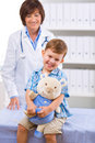 Doctor examining child Stock Photography