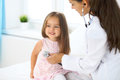 Doctor examining a little girl by stethoscope Royalty Free Stock Photo