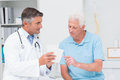 Doctor explaining prescription to senior patient Royalty Free Stock Photo