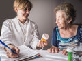 Doctor explains to elderly daily dose of medication Royalty Free Stock Photo