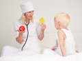 Doctor giving apple and pills Royalty Free Stock Photo