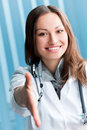 Doctor giving hand for handshake Stock Photo