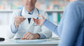Doctor giving a medical prescription to the patient Royalty Free Stock Photo