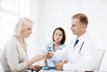 Doctor giving tablets to patient in hospital healthcare and medical concept Royalty Free Stock Photo