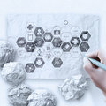 Doctor hand draws medical network on crumpled paper as concept Royalty Free Stock Photos