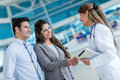 Doctor handshaking a couple with at the hospital Royalty Free Stock Image