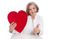 Doctor with heart thumbs up disease isolated in her hand Royalty Free Stock Images