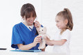 Doctor and her little patient Royalty Free Stock Photo