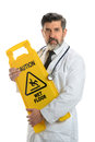 Doctor holding caution sign hispanic isolated over white background Royalty Free Stock Images