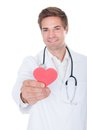 Doctor holding heart portrait of a happy male red shape Royalty Free Stock Photography