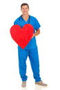 Doctor holding heart shape attractive young on white background Royalty Free Stock Images